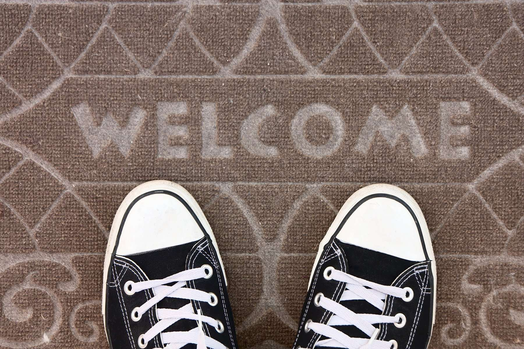Onboarding | Shoes on Welcome Mat